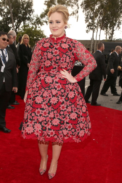 I'm sorry but Adele was worst dressed at the 2013 Grammys. She wore a flower printed dress by Valentino.
