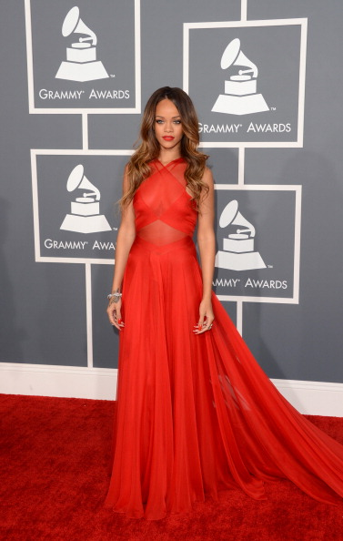 Rihanna looks red-hot at the Grammys in custom Alaia Couture.
