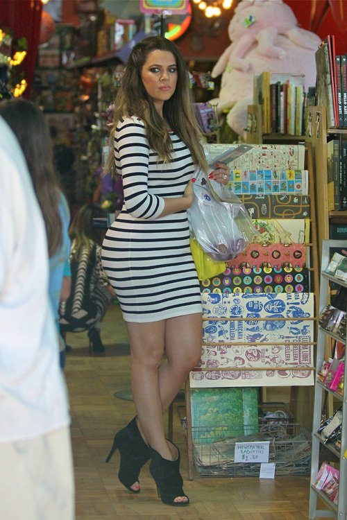 Khloe Kardashian shops at Wacko in LA in an Exclusive for Intermix Contrast Zipper Striped Dress