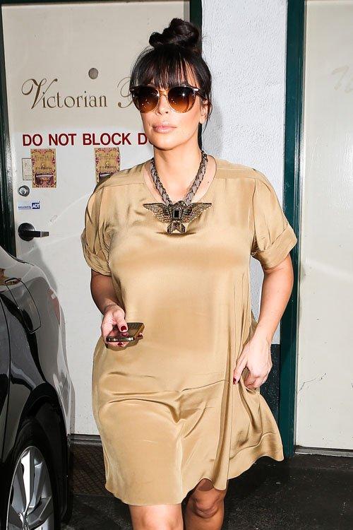 Kim Kardashian looks cute in a 3.1 Phillip Lim T-Shirt Dress ($495) and a Lanvin Maria Felix Line Eagle Necklace ($1,985)