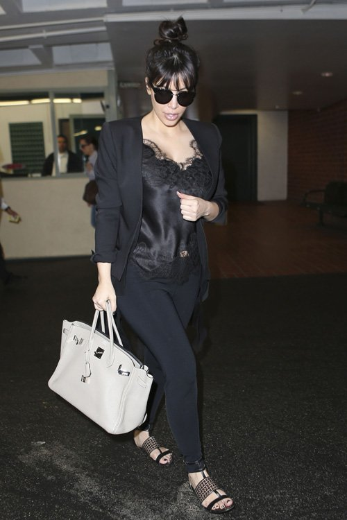 Kim Kardashian opted for all black while leaving a Nail Salon wearing a Carine Gilson Sonia V-Neck Lace Camisole and Azzedine Alaia Black Patent Leather Flats