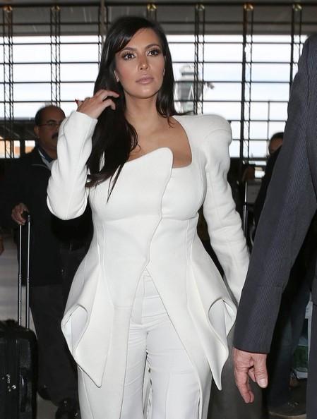 Kim Kardashians LAX in a Mugler Fall-2012 Dress and Trousers jinnaloves.comPic2