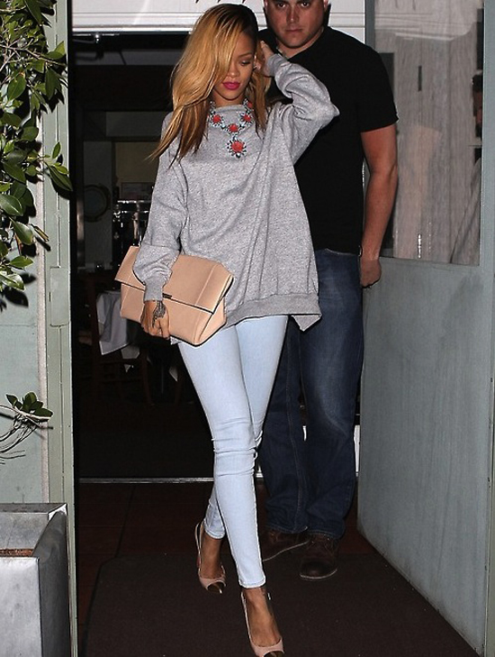 Rihanna in J Brand Jeans Prada Spring 2012 Necklace and Céline Nude Folded Clutch www.jinnaloves.com