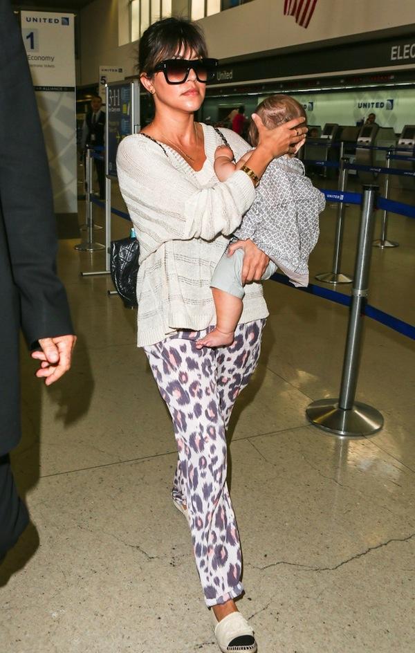 Kourtney Kardashian at LAX Airport in Kardashian Kollection Leopard Print Drawstring Pants www.jinnaloves.com