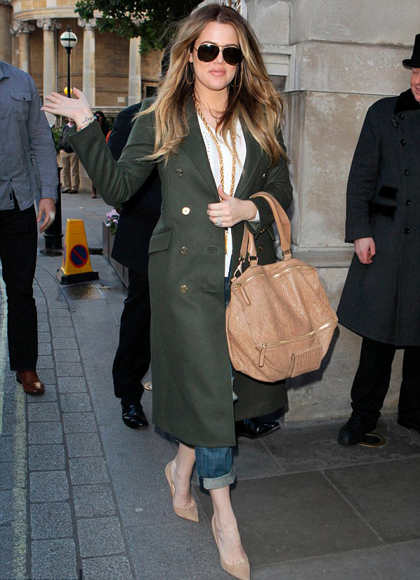 Khloe Kardashian in London rocking a  Balmain Green Double Breasted Military Coat Kardashian Kollection Rag and Bone Jeans and Saint Laurent Pumps www.jinnaloves.com