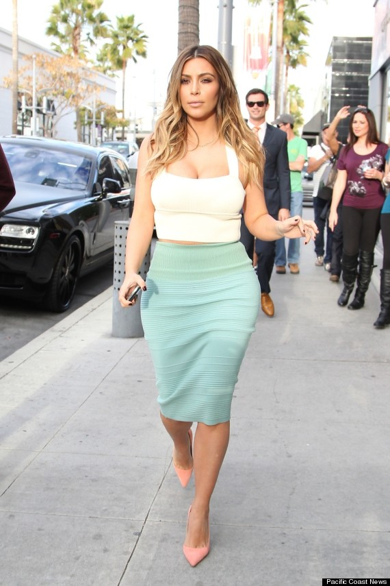Kim Kardashian white crop top and green pencil skirt www.jinnaloves.comPic1