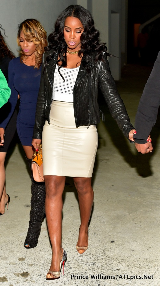 Kelly-Rowland-topped-a-tan-skirt-and-a-perforated-tank-off-with-a-leather-jacket-and-Christian-Louboutin-pumps.-Hot