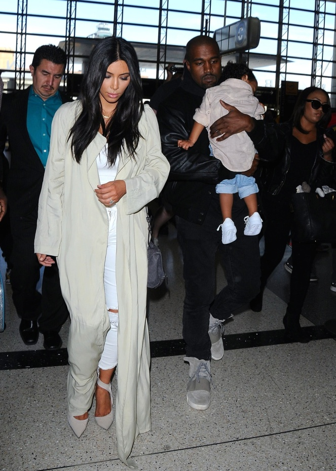 Kim Karadashian, Kanye and North make their way through LAX