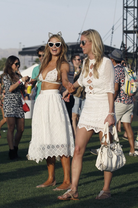 Paris and Nicky Hilton seen wearing white dresses on International Siblings day during Coachella Music Festival